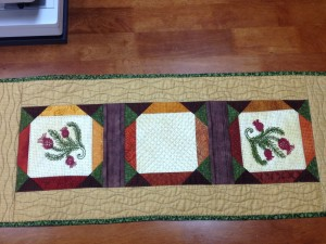 Scenes of Spring and Fall Table Runner with bobbin work (back)